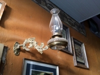 One of the original lamps hangs in the hallway of the Idaho Hotel in SIlver City, ID. Photo by Brianna Griff